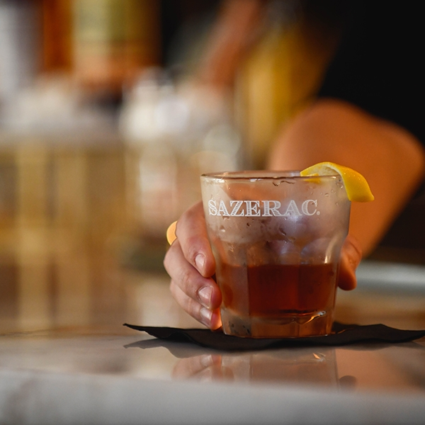 a sazerac cocktail being served