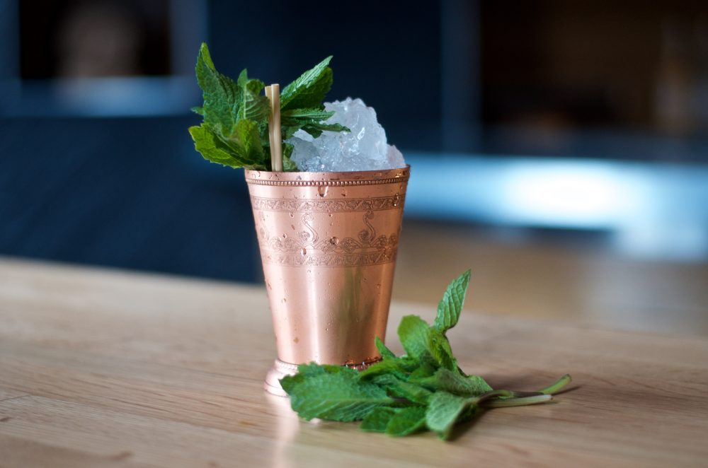 Mint Julep cocktail in copper cup with mint garnish