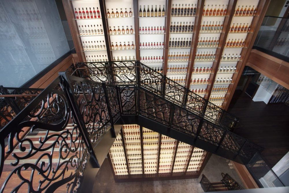Monumental staircase in frotn of bottle wall