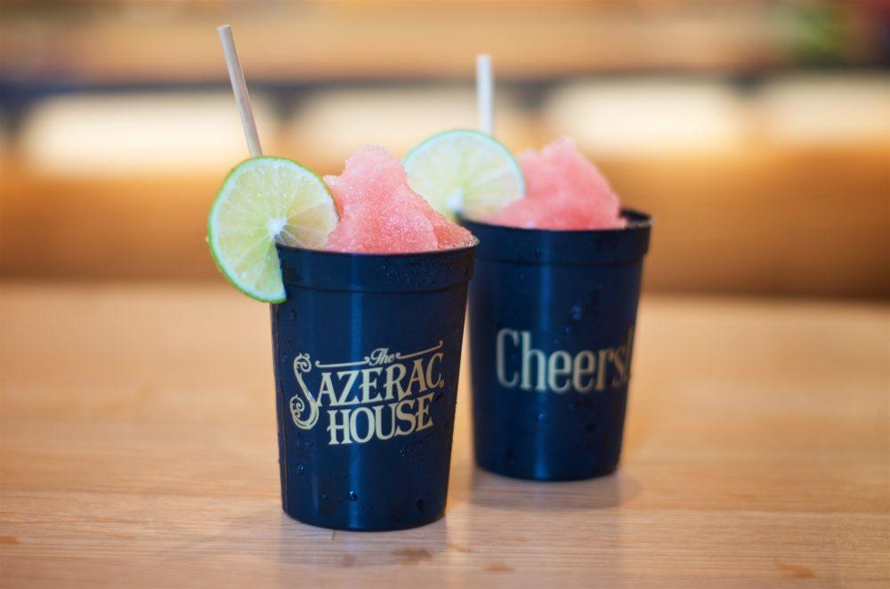 2 Frozen drinks in black plastic cups